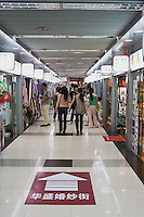 people in the shopping sections of a metro station in Shanghai China