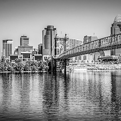 Cincinnati Skyline and Roebling Bridge black and white photo. Picture includes Cincinnati skyline, John A. Roebling bridge, and downtown city office buildings with Great American Insurance Group Tower, Omnicare building, Scripps Center building, PNC Tower Building, Carew Tower, US Bank Building, and Fifth Third Bank building. Photo is high resolution and was taken in July 2012.