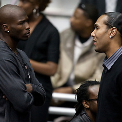 Dec 22, 2009; Westwego, LA, USA;  Cincinnati Bengals teammates Chad Ochocinco (left) and  T. J. Houshmandzadeh (right) pay their respects during funeral services for Cincinnati Bengals wide receiver Chris Henry held at the Alario Center. Mandatory Credit: Derick E. Hingle-US PRESSWIRE