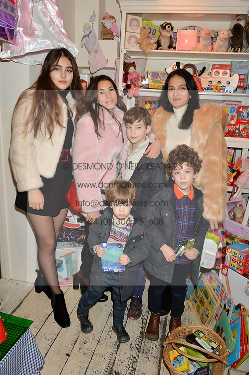 Left to right, MADDIE MILLS, LAUREN KEMP, REX KEMP,  MILO KEMP, KIT KEMP and YASMIN MILLS at a promotional party for the A Girl For All Time doll held at HoneyJam, 2 Blenheim Crescent, London on 5th December 2015.