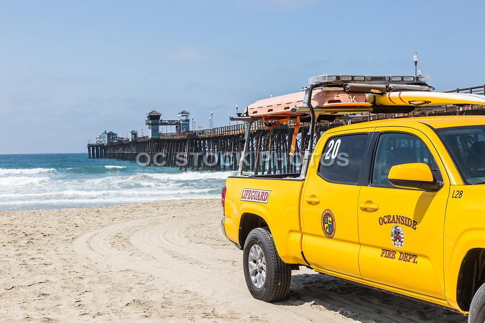 Yellow Lifeguard Truck on the Beach at Oceanside Pier