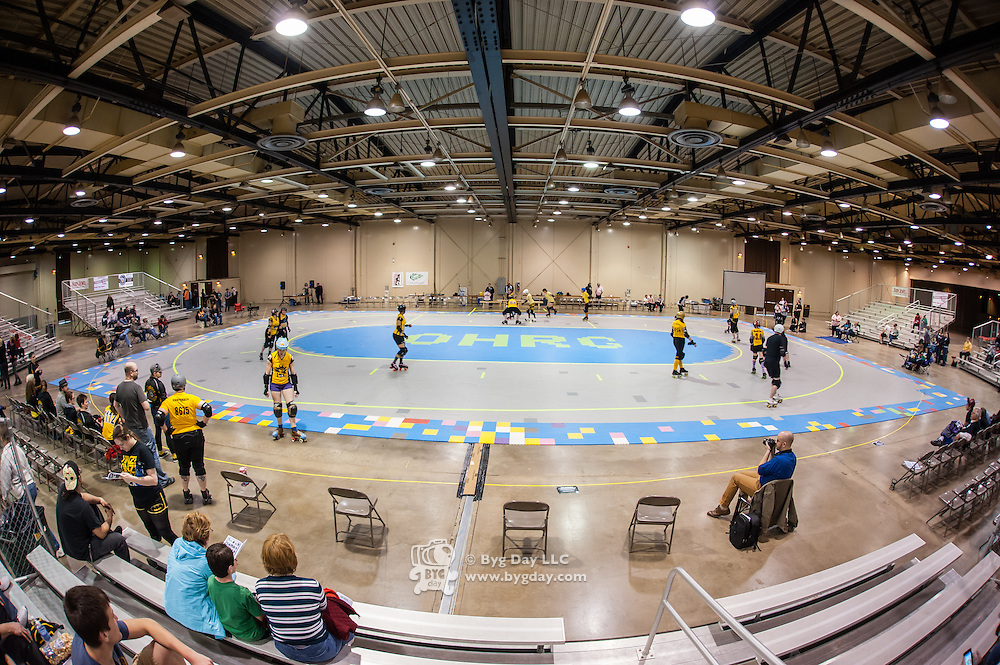 Wide angle view of the floor before the bouts start. ..Pittsburgh, PA, Steel Hurtin' VS. the Ohio Roller Girls All Stars..Pittsburg PA Steel Beamers VS. Ohio Roller Girls Gang Green ..6 April 2013: at Louche Building - Ohio Expo Center in Columbus, Ohio. Dorn Byg/Byg Day LLC