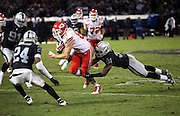 Kansas City Chiefs tight end Travis Kelce (87) catches a 10 yard pass short of the first down as he gets tackled on the play by Oakland Raiders defensive back Neiko Thorpe (31) in the third quarter during the NFL week 12 regular season football game against the Oakland Raiders on Thursday, Nov. 20, 2014 in Oakland, Calif. The Raiders won their first game of the season 24-20. ©Paul Anthony Spinelli