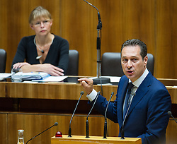 03.07.2013, Parlament, Wien, AUT, Parlament, 213. Nationalratssitzung, Sitzung des Nationalrates. im Bild Klubobmann FPOe Heinz-Christian Strache vor Bundesministerin fuer Justiz Dr. Beatrix Karl OeVP // Leader of the parliamentary group FPOe Heinz Christian Strache in front of Minister of justice Dr. Beatrix Karl OeVP  during the 213th meeting of the national assembly of austria, austrian parliament, Vienna, Austria on 2013/07/03, EXPA Pictures © 2013, PhotoCredit: EXPA/ Michael Gruber