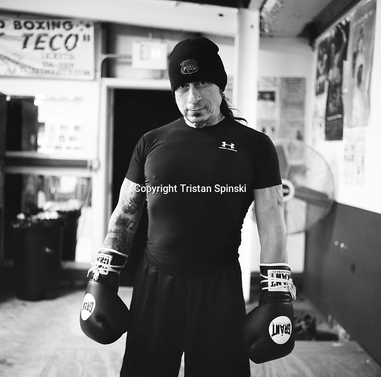 Ray Gunn, a former professional boxer and current musician, stand for a portrait in SJ Boxing Gym in downtown Fort Myers in January of 2010.