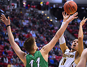 SAN DIEGO, CA - MARCH 16:  Landry Shamet #11 of the Wichita State Shockers shoots against Ajdin Penava #11 of the Marshall Thundering Herd during a first round game of the Men's NCAA Basketball Tournament at Viejas Arena in San Diego, California. Marshall won 81-75.  (Photo by Sam Wasson)