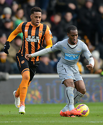 Newcastle United's Vurnon Anita competes with Hull City's Abel Hernandez - Photo mandatory by-line: Richard Martin-Roberts/JMP - Mobile: 07966 386802 - 31/01/2015 - SPORT - Football - Hull - KC Stadium - Hull City v Newcastle United - Barclays Premier League