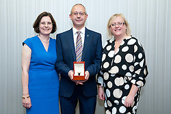 Pictured is, from left, Lincolnshire Co-operative chief executive Ursula Lidbetter, Richard Lister, Lincolnshire Co-operative president Amy Morley<br /> <br /> Lincolnshire Co-operative long service awards 2015, held at The Showroom, Tritton Road, Lincoln.<br /> <br /> Date: September 23, 2015<br /> Picture: Chris Vaughan/Chris Vaughan Photography