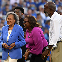 Racheal Robinson, center, widow of Jackie Robinson tossed out the ceremonial pitch prior to game one of a World Series baseball game against the Houston Astros at Dodger Stadium on Tuesday, Oct. 24, 2017 in Los Angeles. (Photo by Keith Birmingham, Pasadena Star-News/SCNG)