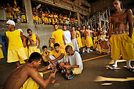 Members of the Mara 18 gang incarcerated in Izalco men's prison in El Salvador pass the afternoon playing cards in the prison yard.