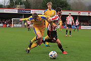 Johnny Hunt and Ryan Jennings during the Vanarama National League match between Cheltenham Town and Chester City at Whaddon Road, Cheltenham, England on 5 December 2015. Photo by Antony Thompson.