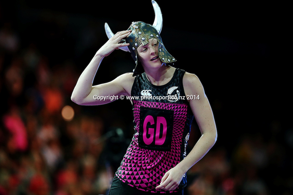 Katrina Grant of New Zealand runs on to the court with a helmet. Fast5 Netball World Series, Day 1, New Zealand Fast5 Ferns v England at Vector Arena, Auckland, New Zealand. Saturday 8 November 2014. Photo: Anthony Au-Yeung / photosport.co.nz