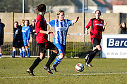Charlotte Gurr advances through midfield during the FA Women's Sussex Challenge Cup semi-final match between Brighton Ladies and Hassocks Ladies FC at Culver Road, Lancing, United Kingdom on 15 February 2015. Photo by Geoff Penn.