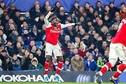 Arsenal forward Nicolas Pépé (19) appeals to the referee for handball during the Premier League match between Chelsea and Arsenal at Stamford Bridge, London, England on 21 January 2020.