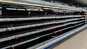 MERTHYR TYDFIL, WALES - 21 MARCH 2020 - Empty fridges in local supermarkets as shoppers continue to panic buy during the the coronavirus epidemic.