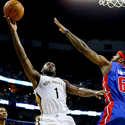 Dec 11, 2013; New Orleans, LA, USA; New Orleans Pelicans point guard Tyreke Evans (1) shoots over Detroit Pistons small forward Josh Smith (6) during the second quarter at New Orleans Arena. Mandatory Credit: Derick E. Hingle-USA TODAY Sports