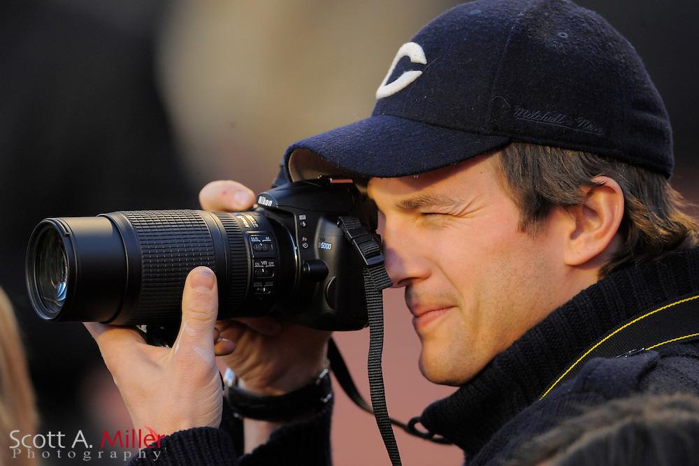 Miami, FL, USA; Miami, FL, USA; Feb 7, 2010; Actor Ashton Kutcher, looks though his Nikon prior to Super Bowl XLIV at Sun Life Stadium. The New Orleans Saints 31-17 beat the Indianapolis Colts..©2010 Scott A. Miller