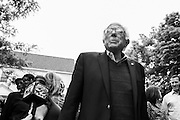 Democratic presidential candidate, Sen. Bernie Sanders, I-Vt prepares to speak at a press conference out front of his home in Burlington, VT, Sunday, June 12, 2016. (AP Photo/Cheryl Senter)