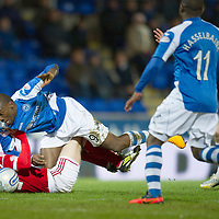 St Johnstone v Aberdeen.....30.01.13      SPL<br /> Gregory Tade is brought down by Mark Reynolds<br /> Picture by Graeme Hart.<br /> Copyright Perthshire Picture Agency<br /> Tel: 01738 623350  Mobile: 07990 594431