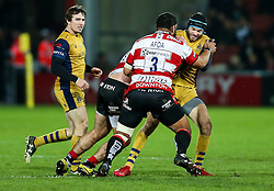 Ryan Edwards of Bristol Rugby is tackled by John Afoa of Gloucester Rugby - Rogan Thomson/JMP - 03/12/2016 - RUGBY UNION - Kingsholm Stadium - Gloucester, England - Gloucester Rugby v Bristol Rugby - Aviva Premiership.