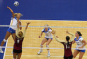 UCLA's Zoe Nightingale (13) goes for a kill against Florida State's Visnja Djurdjevic (9) during game action of the 2011 NCAA Division I Women's Volleyball Championship National Semifinal Match #1 at the Alamodome on Thursday, Dec. 15, 2011. UCLA defeated Florida State in straight sets, 25-16, 25-17, 25-21.