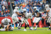 NASHVILLE, TN - NOVEMBER 29:  Latavius Murray #28 of the Oakland Raiders runs the ball during a game against the Tennessee Titans at Nissan Stadium on November 29, 2015 in Nashville, Tennessee.  The Raiders defeated the Titans 24-21.  (Photo by Wesley Hitt/Getty Images) *** Local Caption *** Latavius Murray