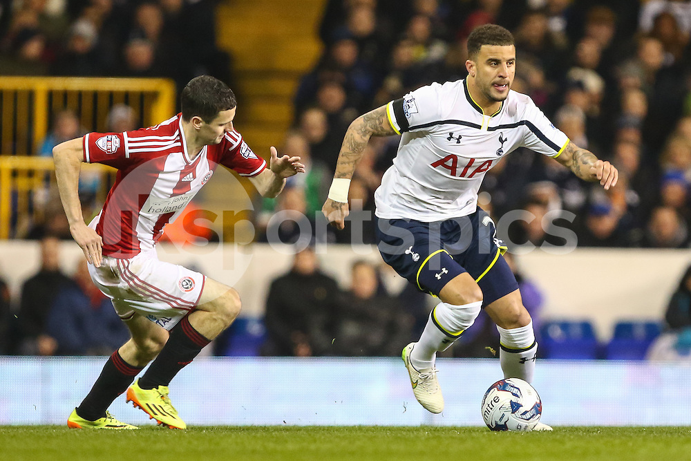 Kyle Walker of Tottenham Hotspur (right) and Jamie Murphy of Sheffield United (left) during the Capital One Cup Semi-Final 1st Leg match between Tottenham Hotspur and Sheffield Utd at White Hart Lane, London, England on 21 January 2015. Photo by David Horn.