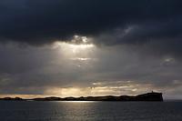 Elliðaey  Breiðafirði. Dramatísk ský og falleg birta speglast í haffletinum.