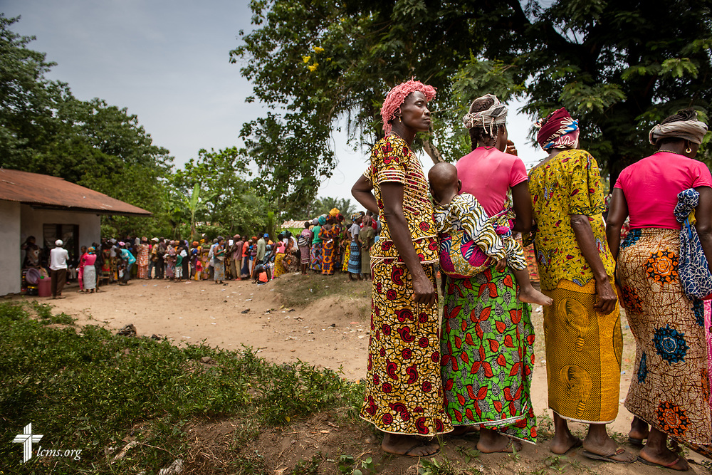 Patients line up for treatment on the fourth day of the LCMS Mercy Medical Team on Thursday, May 10, 2018, in the Yardu village outside Koidu, Sierra Leone, West Africa. LCMS Communications/Erik M. Lunsford