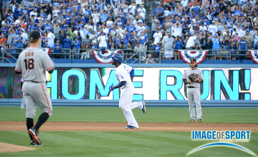 Apr 6, 2014; Los Angeles, CA, USA; Los Angeles Dodgers shortstop Hanley Ramirez (13) rounds the bases after hitting a home in the fourth inning as San Francisco Giants pitcher Matt Cain (18) and shortstop Brandon Crawford (35) watch at Dodger Stadium. Ramirez hit two home runs in the Dodgers 6-2 victory.