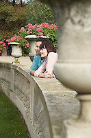 Couple looking over wall head and shoulders