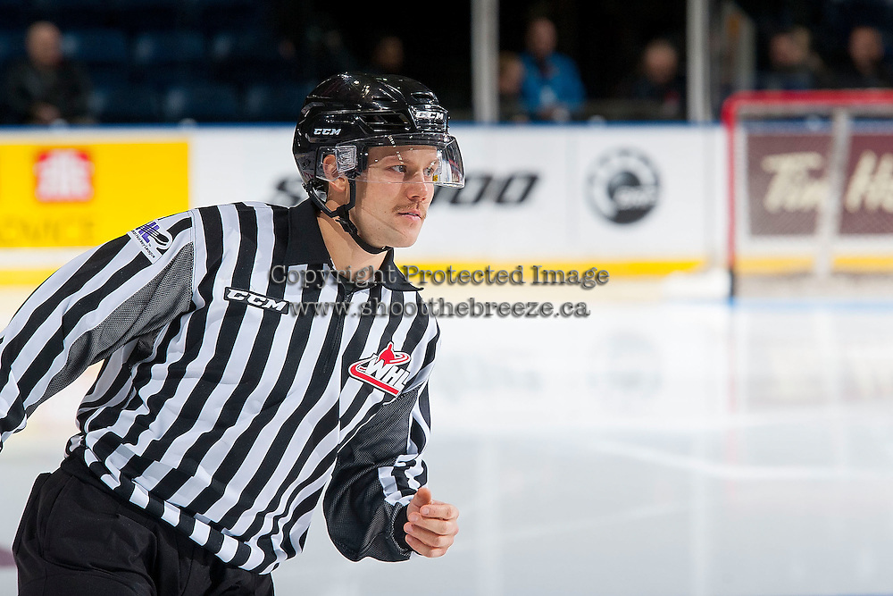 KELOWNA, CANADA - NOVEMBER 9: Linesman Dustin Minty enters the ice between Team WHL and Team Russia on November 9, 2015 during game 1 of the Canada Russia Super Series at Prospera Place in Kelowna, British Columbia, Canada.  (Photo by Marissa Baecker/Western Hockey League)  *** Local Caption *** Dustin Minty;
