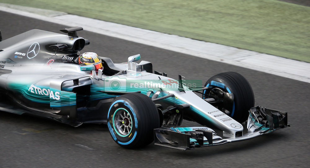 Lewis Hamilton in the new Mercedes W08 Formula One car during the Mercedes-AMG 2017 Car Launch at Silverstone, Towcester.
