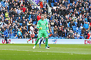 Brighton keeper David Stockdale  celebrates after saving a penalty during the Sky Bet Championship match between Brighton and Hove Albion and Birmingham City at the American Express Community Stadium, Brighton and Hove, England on 21 February 2015.