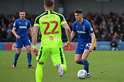 AFC Wimbledon midfielder Callum Reilly (33) dribbling during the EFL Sky Bet League 1 match between AFC Wimbledon and Bolton Wanderers at the Cherry Red Records Stadium, Kingston, England on 7 March 2020.