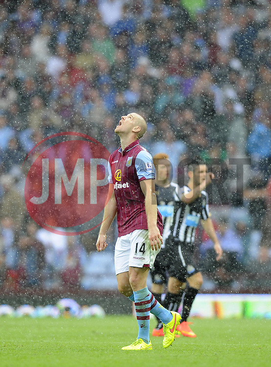Aston Villa's Phillip Senderos looks to the sky in frustration - Photo mandatory by-line: Joe Meredith/JMP - Mobile: 07966 386802 23/08/2014 - SPORT - FOOTBALL - Birmingham - Villa Park - Aston Villa v Newcastle United - Barclays Premier League