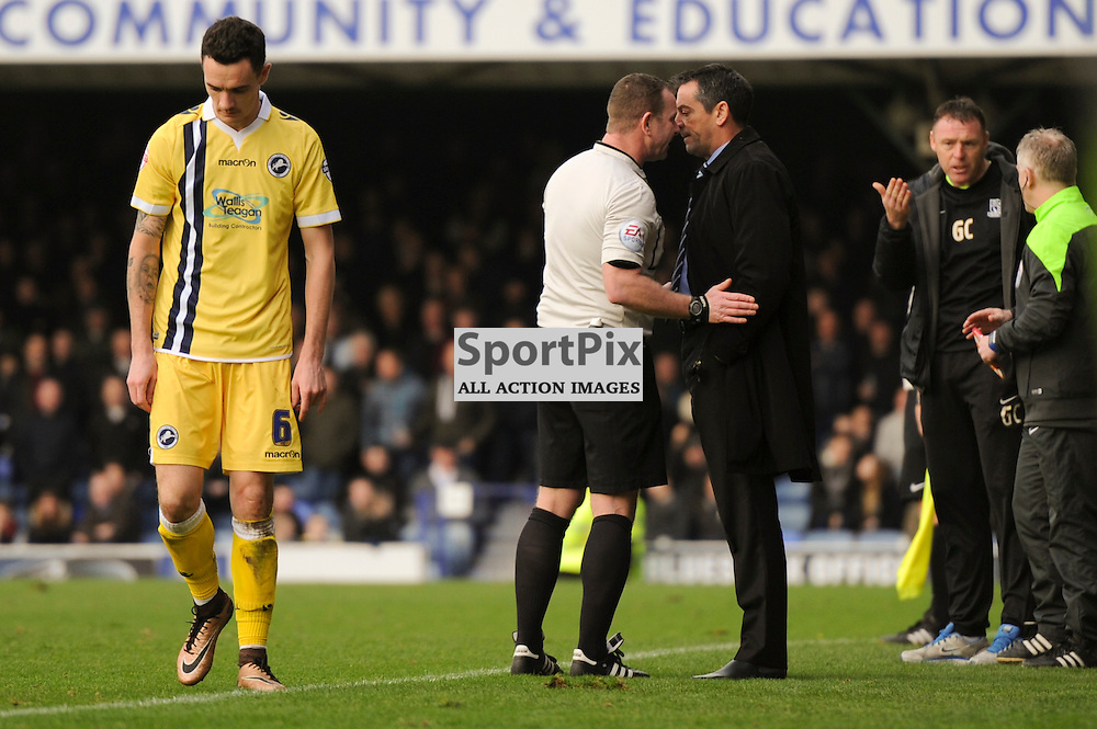 Referee Kevin Wright has a word with Southends manager Phil Brown during the Southend v Millwall game in the Sky Bet League 1 on the 28th December 2015.