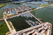 Nederland, Noord-Holland, Amsterdam, 14-06-2012; IJburg, Steigereiland, IJburglaan (midden), drijvende huizen. Enneüs Heermabrug en Zeeburgerbrug (boven in beeld)..New constructed urban development, residential district IJburg , floating houses..luchtfoto (toeslag), aerial photo (additional fee required).foto/photo Siebe Swart