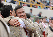 BEA AHBECK/NEWS-SENTINEL<br /> Amadores Luso Americanos de Turlock's Ulysses Gutierrez gets a congratulatory hug after grabbing his second bull of the year during the bloodless bullfight during the Our Lady of Fatima Portuguese Festival in Thornton Saturday, Oct. 15, 2016.