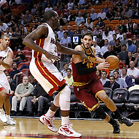 24 January 2012: Cleveland Cavaliers small forward Omri Cassi (36) drives past Miami Heat center Joel Anthony (50) during the Miami Heat 92-85 victory over the Cleveland Cavaliers at the AmericanAirlines Arena, Miami, Florida, USA.