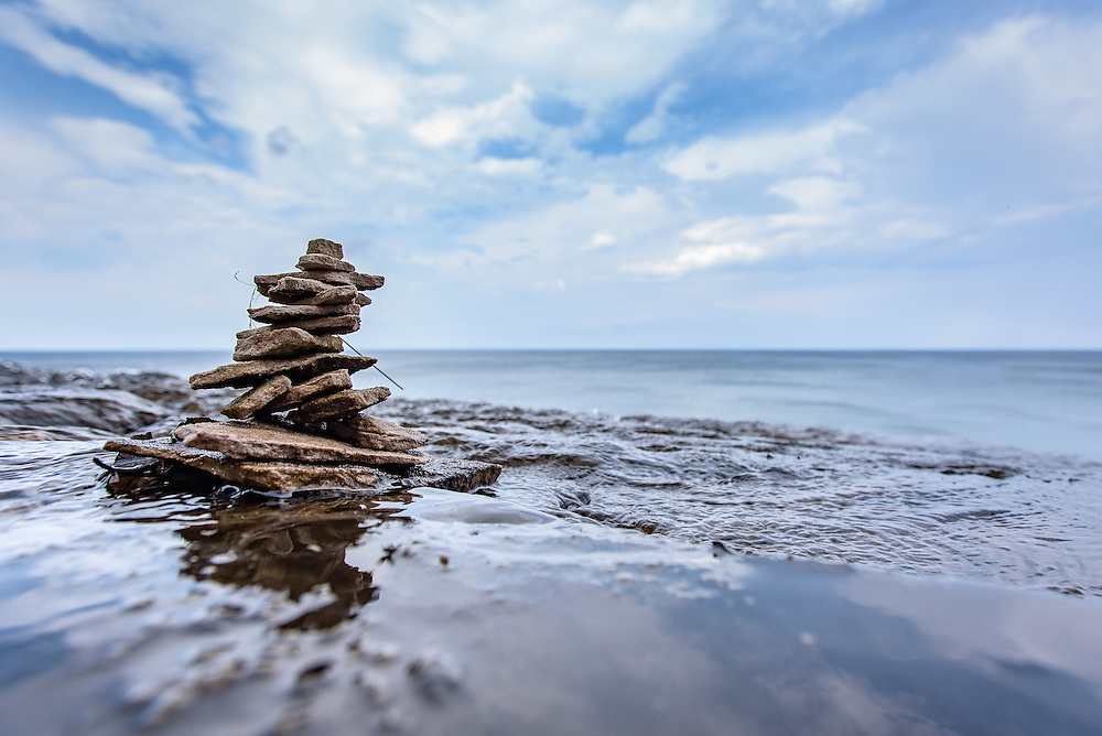 PICTURED ROCKS NATIONAL LAKESHORE - October 2016: Rock cairns out in the wilderness are traditionally used to mark a trail especially in the mountains above tree line. As I'm out hiking I've been seeing more of these rock stacking sculptures people have made. This one was at the top of Spray Falls about three feet from the edge before plunging 70 feet straight down to Lake Superior in Pictured Rocks National Lakeshore.<br />