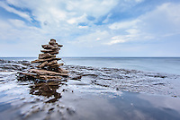 PICTURED ROCKS NATIONAL LAKESHORE - October 2016: Rock cairns out in the wilderness are traditionally used to mark a trail especially in the mountains above tree line. As I'm out hiking I've been seeing more of these rock stacking sculptures people have made. This one was at the top of Spray Falls about three feet from the edge before plunging 70 feet straight down to Lake Superior in Pictured Rocks National Lakeshore.<br /> Photographer Bryan Mitchell was this years Artist in Residence at Pictured Rocks National Lakeshore in the Upper Peninsula of Michigan from Oct. 1-17, 2016 near Munising, Michigan. (Photo by Bryan Mitchell)