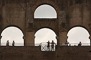 Tourists in the Colosseum, Rome, Italy