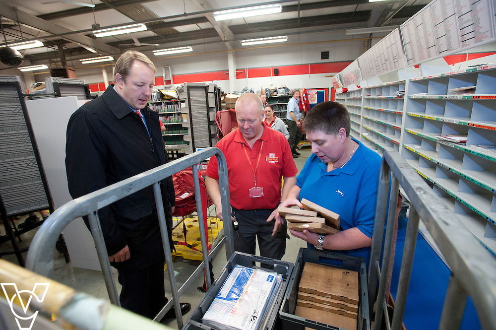 Toby Perkins MP, left, talks to Keith Mosley, centre, and Sharon Reynolds, right, during his visit to the Royal Mail's Staveley Delivery Office, in Chesterfield.<br /> <br /> Date: November 28, 2014