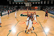 February 20, 2014: Cornelia Fondren #11 of Syracuse shoots over Jassany Williams #21 and Krystal Saunders #12 of Miami during the NCAA basketball game between the Miami Hurricanes and the Syracuse Orange at the Bank United Center in Coral Gables, FL. The Orange defeated the Hurricanes 69-48.