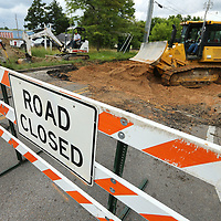 Work crews tear up the asphalt on Lumpkin Ave at the Main Street intersection on Tuesday afternoon as work has begun on lining up Lumpkin Ave with Monument Drive in Tupelo.