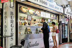 Customers buying food from a fast food outlet in Chelmsford market.