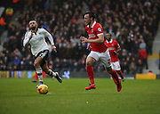 Charlton Athletic defender, Morgan Fox (21) powering away from Fulham defender Ryan Fredericks (07) during the Sky Bet Championship match between Fulham and Charlton Athletic at Craven Cottage, London, England on 20 February 2016. Photo by Matthew Redman.