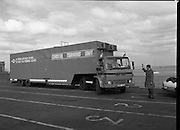 B.I.M.Training Vehicle.  (R31)..1986..11.04.1986..04.11.1986..11th April 1986..B.I.M's Coastal training unit left Ireland today to visit the major fishing ports of Brittany. Over the next three weeks demonstrations will be given, to French fishermen, of the types of courses provided by the board for fishermen at their home ports. Staffed by two instructors the unit offers comprehensive courses in navigation,radiotelephony, engine maintenance, electrical systems,Hydraulics and refrigeration. This endeavour is funded by the E.E.C. Commission...Image shows (L-R) Dr Tony Meaney, Chief Executive,B.I.M.,as he waves the training vehicle off as it prepares to board the ferry on route to France.