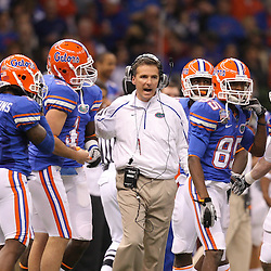 Jan 01, 2010; New Orleans, LA, USA; Florida Gators head coach Urban Meyer talks to his special teams unit during the first half against the Cincinnati Bearcats during the 2010 Sugar Bowl at the Louisiana Superdome.  Mandatory Credit: Derick E. Hingle-US PRESSWIRE.